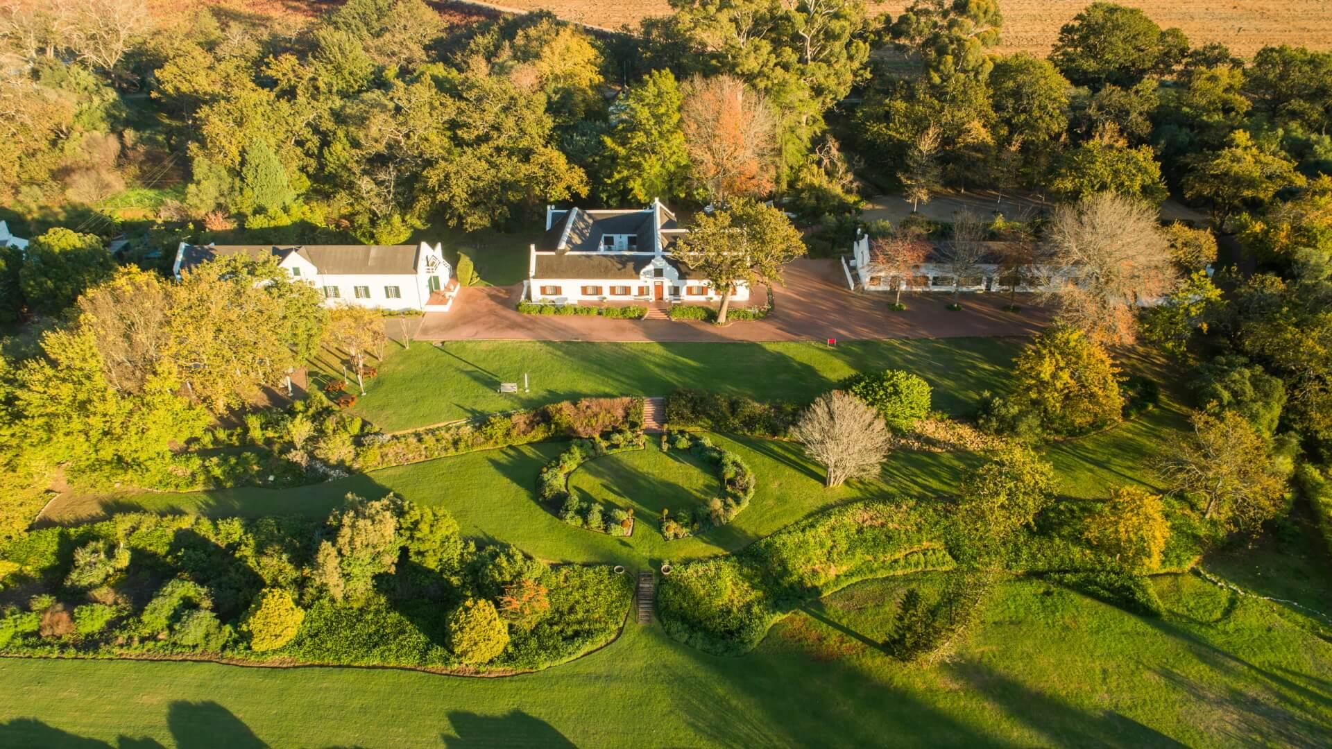Aerial View of Plaisir de Merle's wine tasting area and lush lawn in Franschhoek